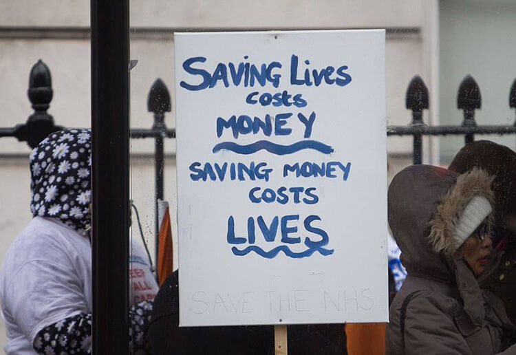 A Horton supporter's placard reading Saving Lives Costs Money - Saving Money Costs Lives.