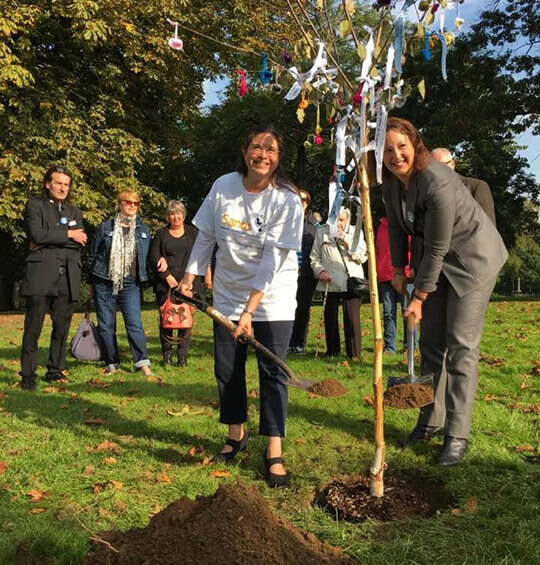 Victoria Prentis and Karen Hancox plant our Tree of Remembrance in Peoples Park